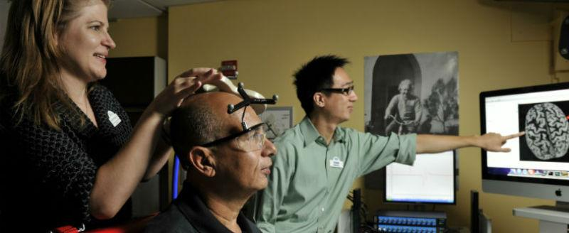 Researchers scanning a brain
