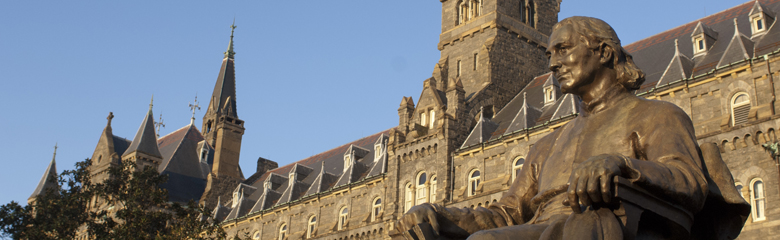 Picture of Carroll statue with Healy Hall in the background